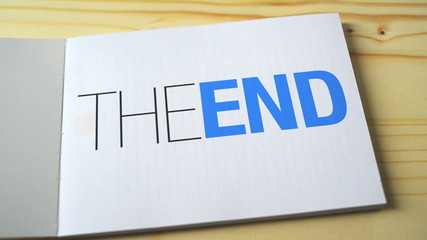 The end printed on the notebook page. 1920x1080 full hd footage.