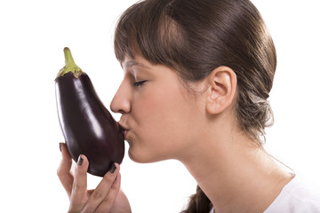 Woman kissing eggplant. Isolated picture.