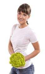 Smiling woman with green salad, isolated on white