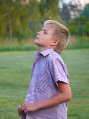 Boy costs on a meadow in rural areas