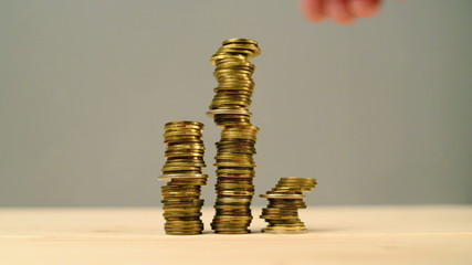 Hand stacking coins. Saving money, managing home budget.