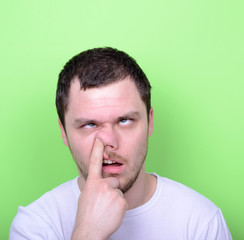 Portrait of a funny guy with finger in his nose