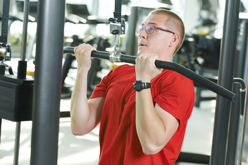man doing exercises at fitness gym