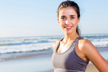 fit woman portrait on beach
