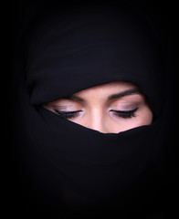 Portrait of beautiful Arab woman wearing black scarf