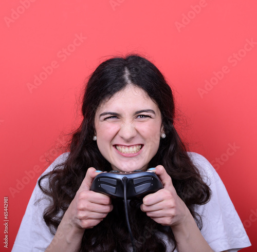 Portrait of girl holding game controller and playing games again