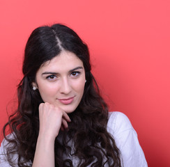 Portrait of happy satsified woman against red background