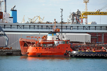 Bunker ship and tugboat under port crane, Odessa, Ukraine