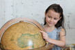 Child looking at globe with smiling face
