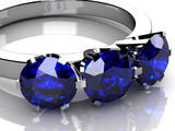beautiful ring with blue gem isolated on white - 65444301
