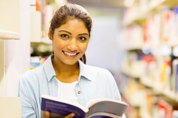 gorgeous indian college girl reading a book