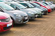 Row of different used cars - 65444581