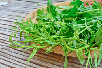 Water spinach on bamboo basket