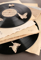 Old vinyl records with  old paper and butterflies,