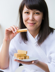 Close-up Portrait of young pretty woman with rage eats wafer