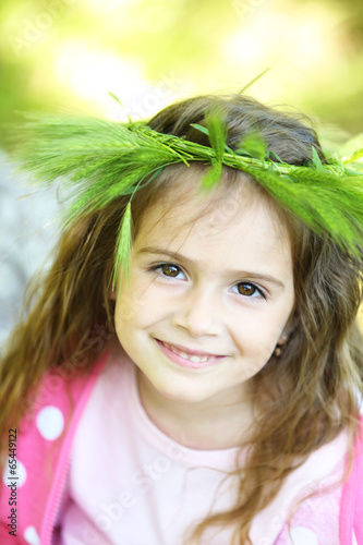 Happy little girl in the green park