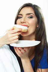 Woman eat donut. Close up portrait. Isolated