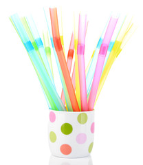 Straws in cup isolated on white