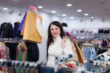 Portrait of prety woman with shopping bags at fashionable store
