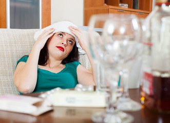 Suffering woman having headache