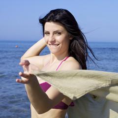Happy smiling woman in bikini on the beach