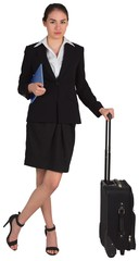 Businesswoman leaning on her suitcase holding tablet pc