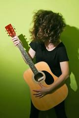 Guitar woman tousling hair