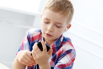 Small boy with mobile phone