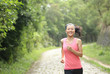 woman runner athlete running on forest trail