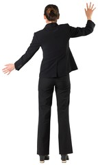 Businesswoman standing with arms up