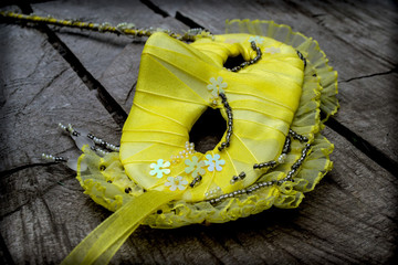 mask with beads and sequins, fashion accessory, yellow