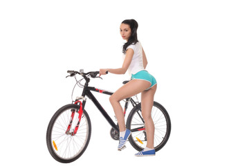 sexy girl with a bike on a white background