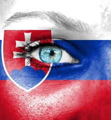 Woman face painted with flag of Slovakia