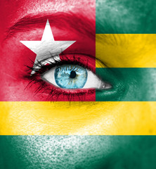 Woman face painted with flag of Togo