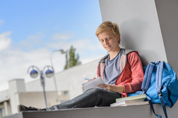 Student boy studying at university campus
