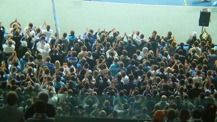 Football fans sector claps and shouts, stadium arena match crowd