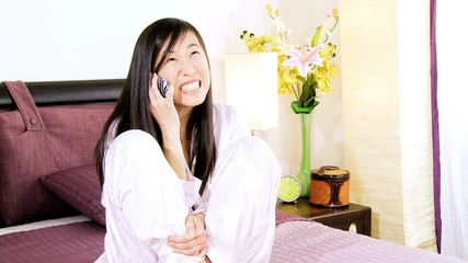 Asian woman in love talking on the phone happy