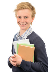 Happy teenage student holding books