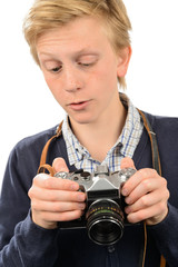 Teenage boy using retro camera