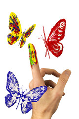 The flock of painted butterflies flying around finger