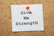 The phrase Give Me Strength on a cork notice board