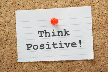 Think Positive message on a cork notice board