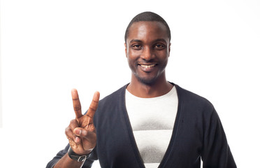 Casual dressed black man showing peace sign. Isolated on white.