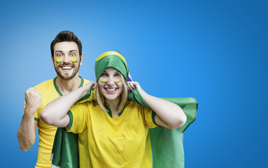 Brazilian couple fan celebrates on blue background