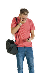 Young handsome guy reading message on mobile phone