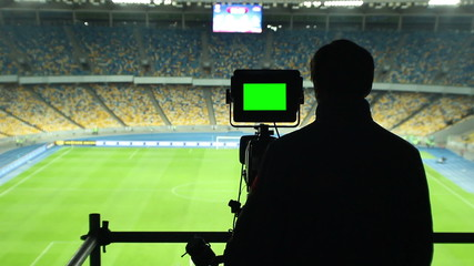 Broadcasting football match TV camera, green screen, coverage