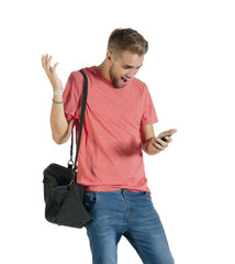 Young handsome guy reacting to message on mobile phone