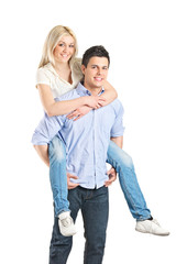 Man giving piggyback ride to his girlfriend