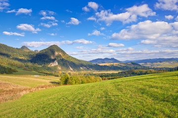 The Pieniny Mountains landscape, Carpathians. Clouds on blue sky