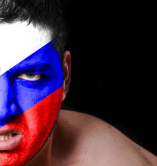 Portrait of angry man with painted flag of Russia